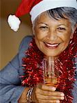 Portrait of a mature woman holding a champagne flute Stock Photo - Premium Royalty-Free, Artist: Marie Blum, Code: 618-00785080