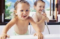 Close-up of two baby boys in a bathtub Stock Photo - Premium Royalty-Freenull, Code: 618-00786075
