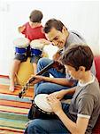 Side profile of two boys and their teacher playing musical instruments Stock Photo - Premium Royalty-Free, Artist: Ed Gifford, Code: 618-00786640