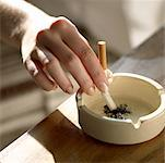 putting out a cigarette Stock Photo - Premium Royalty-Freenull, Code: 621-00787677