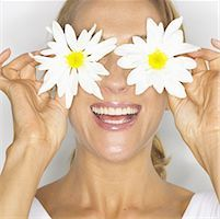 Woman With Flowery Daisy Eyes Stock Photo - Premium Royalty-Freenull, Code: 621-00792931