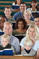 Family Holding Hymnals in Church Stock Photo - Premium Royalty-Freenull, Code: 621-00795274