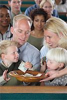 Family in Church Putting Money in Offering Plate Stock Photo - Premium Royalty-Freenull, Code: 621-00795275