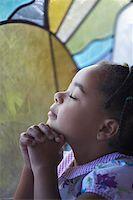 Three Year Old Girl Praying with Eyes Closed Stock Photo - Premium Royalty-Freenull, Code: 621-00795307