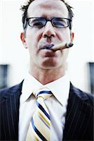 Businessman with Cigar    Stock Photo - Premium Rights-Managednull, Code: 700-00795873