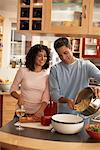 Couple Preparing Dinner    Stock Photo - Premium Rights-Managed, Artist: Jerzyworks, Code: 700-00796234