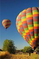 Hot air balloons preparing to take off Stock Photo - Premium Royalty-Freenull, Code: 625-00801449