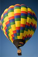 Low angle view of a hot air balloon flying in the sky Stock Photo - Premium Royalty-Freenull, Code: 625-00801490