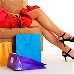 Woman lying on couch with shopping bags on floor Stock Photo - Premium Royalty-Free, Artist: Aurora Photos, Code: 625-00802301
