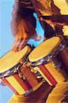 Mid section view of a musician playing the bongo Stock Photo - Premium Royalty-Free, Artist: Westend61                , Code: 625-00802855