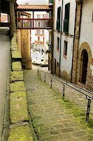High angle view of an empty alleyway leading to the street, Spain Stock Photo - Premium Royalty-Freenull, Code: 625-00804501