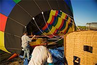 Rear view of two mid adult men near hot air balloon Stock Photo - Premium Royalty-Freenull, Code: 625-00805513