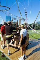Close-up of men climbing into a hot air balloon basket, Boston, Massachusetts, USA Stock Photo - Premium Royalty-Freenull, Code: 625-00805917
