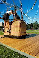 Close-up of a woman climbing into a hot air balloon basket, Boston, Massachusetts, USA Stock Photo - Premium Royalty-Freenull, Code: 625-00805921