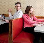 Young Woman Reading Menu in Diner with Man Looking Over Shoulder    Stock Photo - Premium Rights-Managed, Artist: Edward Pond, Code: 700-00819405
