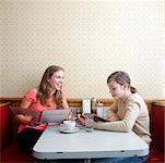 Young Women in Diner Studying Menus    Stock Photo - Premium Rights-Managed, Artist: Edward Pond, Code: 700-00819408