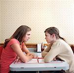 Young Women Staring at Each Other in Diner    Stock Photo - Premium Rights-Managed, Artist: Edward Pond, Code: 700-00819409