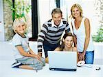 Portrait of parents and their children in front of a laptop Stock Photo - Premium Royalty-Free, Artist: Glowimages               , Code: 618-00830781