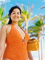 Low angle view of a young woman standing on the beach Stock Photo - Premium Royalty-Freenull, Code: 618-00832905