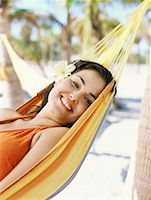 Side view of a young woman lying on her back in a hammock Stock Photo - Premium Royalty-Freenull, Code: 618-00832910