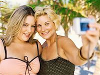 Close-up of two young overweight women taking a picture of themselves Stock Photo - Premium Royalty-Freenull, Code: 618-00832913