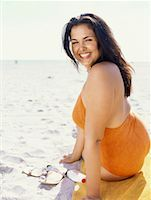 Side view of a young woman sunbathing Stock Photo - Premium Royalty-Freenull, Code: 618-00832927