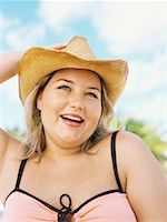 Portrait of a young overweight woman wearing a sun hat Stock Photo - Premium Royalty-Freenull, Code: 618-00832935
