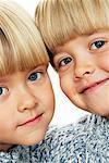 Twin boys (3-5) head to head, portrait, close-up