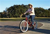 Woman Riding A Bicycle    Stock Photo - Premium Rights-Managednull, Code: 700-00846792
