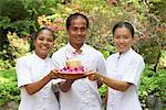 Hotel Staff Holding Coconut Drink Phuket, Thailand    Stock Photo - Premium Rights-Managed, Artist: Steve Craft, Code: 700-00847559