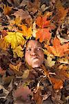 Man Buried Under Leaves    Stock Photo - Premium Rights-Managed, Artist: Jerzyworks, Code: 700-00847668
