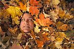 Man Buried Under Leaves    Stock Photo - Premium Rights-Managed, Artist: Jerzyworks, Code: 700-00847669