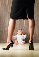 Baby Looking Up At Her Mother    Stock Photo - Premium Royalty-Freenull, Code: 600-00847881