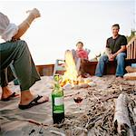 Friends Sitting Around Campfire    Stock Photo - Premium Rights-Managed, Artist: Derek Shapton, Code: 700-00847809