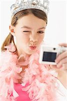 preteen kissing - Girl Taking Picture of Self    Stock Photo - Premium Royalty-Freenull, Code: 600-00847928