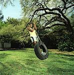 Woman on Tire Swing    Stock Photo - Premium Rights-Managed, Artist: TSUYOI, Code: 700-00848582
