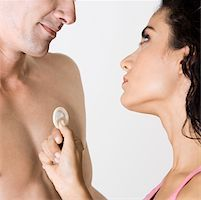 Close-up of a young man and a young woman holding a condom Stock Photo - Premium Royalty-Freenull, Code: 625-00850079
