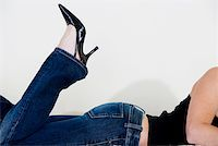 Close-up of a woman wearing stilettos Stock Photo - Premium Royalty-Freenull, Code: 625-00850617