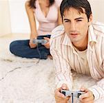 Close-up of young couple playing computer game Stock Photo - Premium Royalty-Freenull, Code: 627-00853243