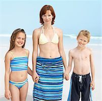 preteen touch - Mother and son (10-11) and daughter (11-12) at the beach Stock Photo - Premium Royalty-Freenull, Code: 627-00856594