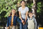 Portrait of a woman walking outdoors with her children (6-10) Stock Photo - Premium Royalty-Freenull, Code: 627-00857752