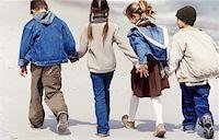 preteen touch - Four children walking on the beach Stock Photo - Premium Royalty-Freenull, Code: 627-00857910