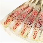 Close-up of four U.K.. fifty pound notes Stock Photo - Premium Royalty-Free, Artist: Garry Black, Code: 627-00858766