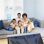 Family lying on the couch Stock Photo - Premium Royalty-Freenull, Code: 627-00860683