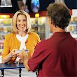 Woman renting films in shop Stock Photo - Premium Royalty-Free, Artist: J. A. Kraulis, Code: 627-00861701