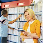 Mid adult couple in a video rental shop Stock Photo - Premium Royalty-Free, Artist: Stellar Stock, Code: 627-00861704