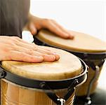 Person playing the bongo Stock Photo - Premium Royalty-Free, Artist: Westend61                , Code: 627-00862684