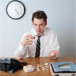 Businessman Taking Pills    Stock Photo - Premium Rights-Managed, Artist: Edward Pond, Code: 700-00864312