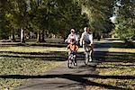 Grandson and Grandparents Riding Bicycles in Park    Stock Photo - Premium Rights-Managed, Artist: George Simhoni, Code: 700-00865103