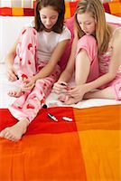 Girl's Painting Toe Nails    Stock Photo - Premium Royalty-Freenull, Code: 600-00866083